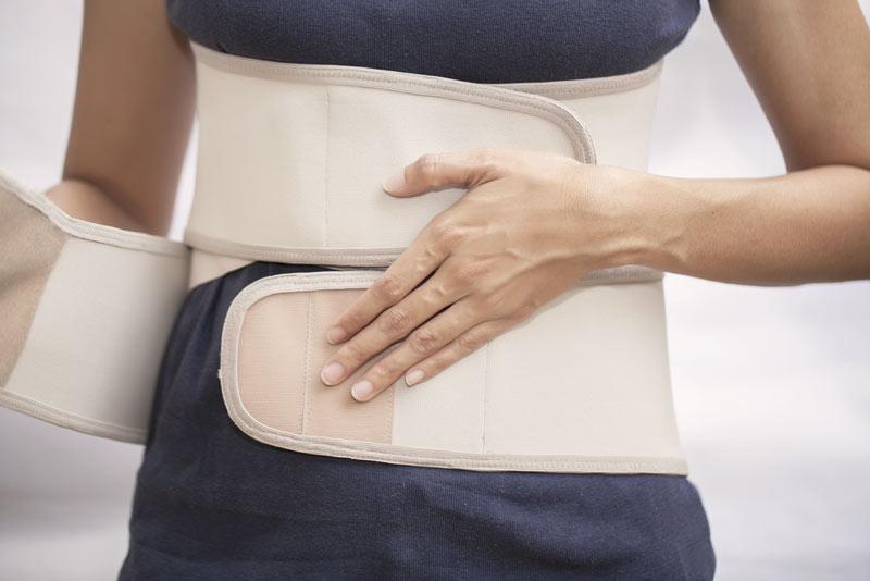 Anpassung von Maßmiedern für die Behandlung von Wirbelsäulenerkrankungen und Korrekturen
